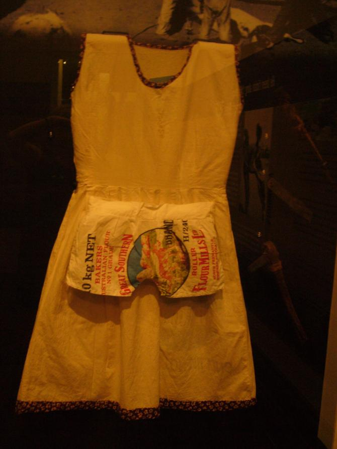 A dress and panties made from flour bags.