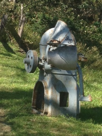 not a Dalek - an old piece of farm machinery now a mail box! Any suggestions what it was originally?