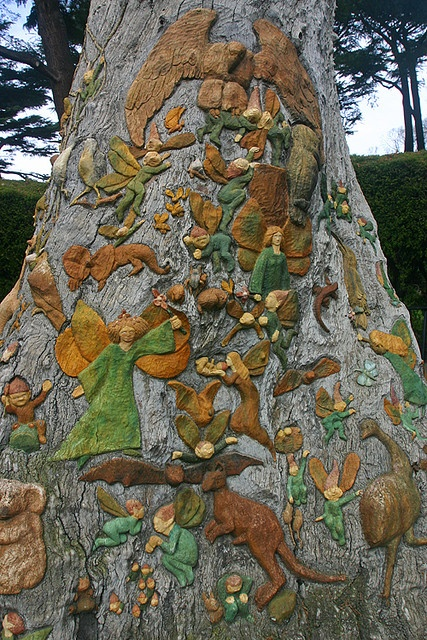 "The Fitzroy Garden in Melbourne Australia has an area with ""Fairy Trees"" that were carved and painted (before 1945) and magical."