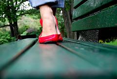 Creatie people wear red shoes