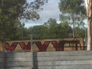 What's a country town without a scrap metal merchant? XXXX or 4X is the original beer of Queenslanders.